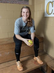 Senior softball pitcher Megan Robertson poses in the dugout at Milton High School on Thursday, February 15, 2018.  Robertson has signed to play with the University of Arkansas next year.