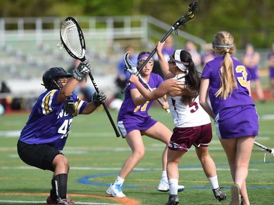 Arlington's Danielle Heady shoots to score on Clarkstown North's goalie, Alexis Guillermo during Wednesday's game at Arlington.