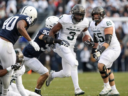 Michigan State running back LJ Scott gives the Spartans