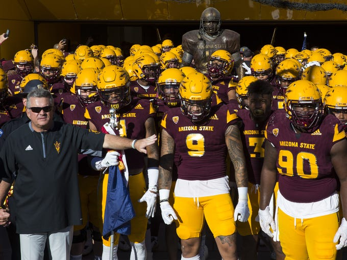 Arizona State head caoch Todd Graham leads his team