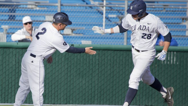 Nevada's Austin Byler gets five from coach Jay Johnson after hitting a solo home run against New Mexico on May 9.