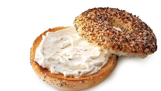 A bagel with cream cheese from Einstein Brothers.