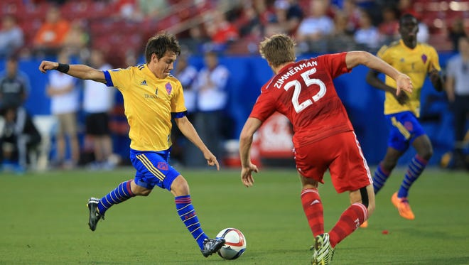 Colorado Rapids midfielder Dillon Serna (17) scores a goal against FC Dallas defender Walker Zimmerman (25) during the second half at Toyota Stadium.