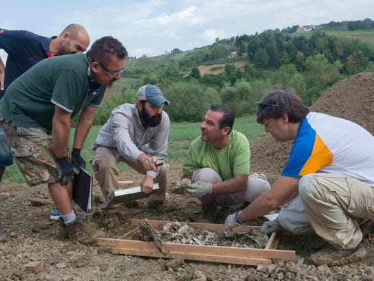 DPAA personnel work to recover remains of a World War