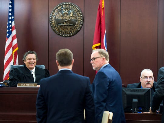 Judge Gale Robinson, far left, chats before hearing