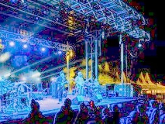 Lighting from the stage turns patrons blue in the mountain