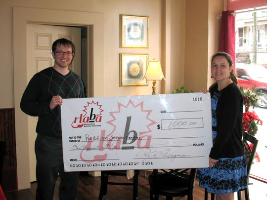 From left: Kyle Wagman, vice president of the Red Lion Business Association, presents a check to Heather Goebeler, director of Red Lion Area Senior Center.