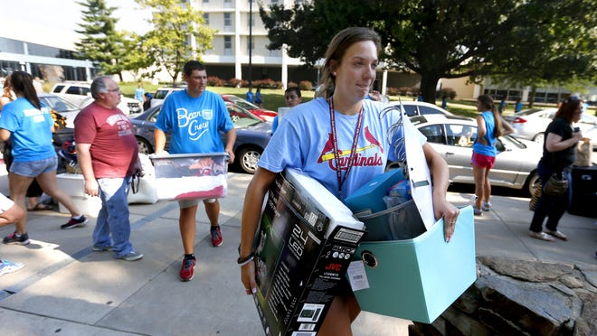 Brittany Schebaum, 19, moves her belongings into Freudenberger House at MSU on Friday.