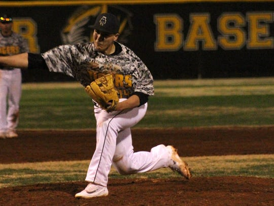 Alamogordo's Gavin Guerra releases a pitch during game