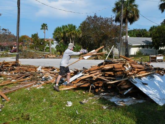 Cleaning uo Hurricane Irma tornado damage in Palm Bay
