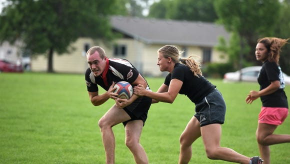 Reporter Alexa Giebink tackled her a player from the