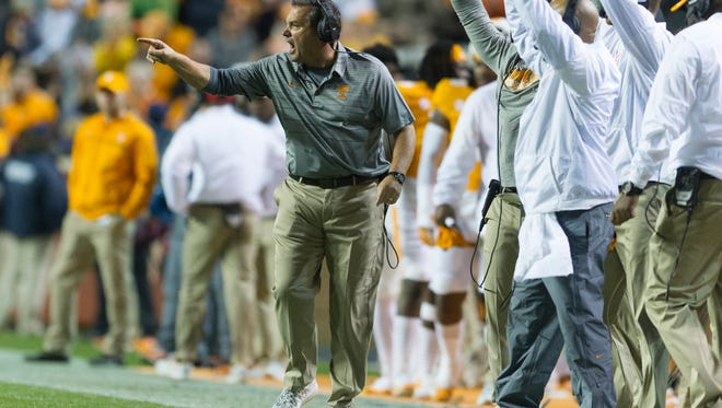 Tennessee interim coach Brady Hoke calls from the sidelines during a game against LSU on Saturday at Neyland Stadium.