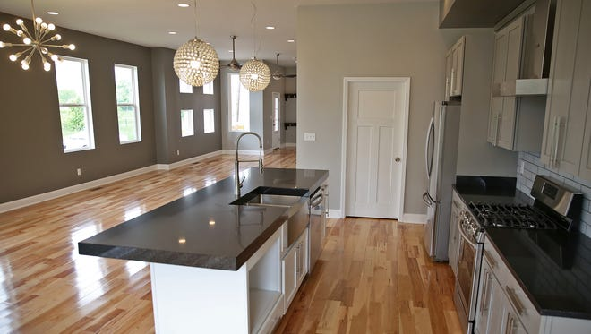 Hickory flooring and and open floor plan are part of the renovations at 902 Woodlawn Avenue, Tuesday, May 10, 2016.  This is the kitchen area off the main open downstairs.