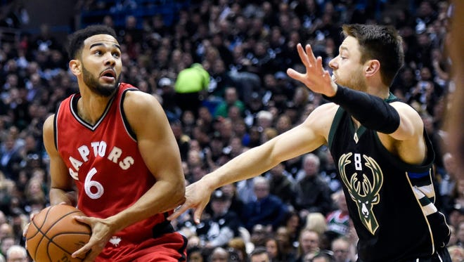 Toronto Raptors guard Cory Joseph (6) looks for a shot against Milwaukee Bucks guard Matthew Dellavedova (8) in the first quarter of Game 3 on Thursday night.