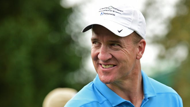 Peyton Manning smiles on the eleventh hole during the pro-am for the the Memorial golf tournament Wednesday, May 30, 2018, in Dublin, Ohio.