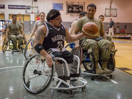 Jose Garcia, center, a player on the Brooklyn Wheelchair