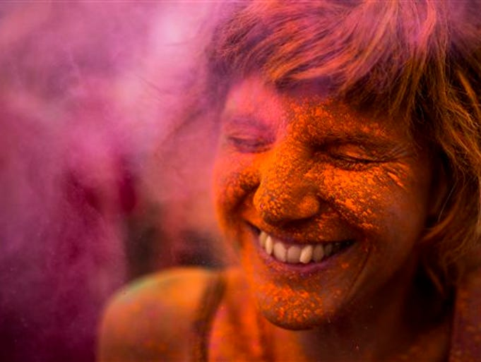 A reveler is covered in coloured powder during a Monsoon Holi Festival in Madrid, Spain, Saturday, Aug. 9, 2014. The festival is based on the Hindu spring festival Holi, also known as the festival of colors where participants color each other with dry powder and colored water.  (AP Photo/Andres Kudacki)
