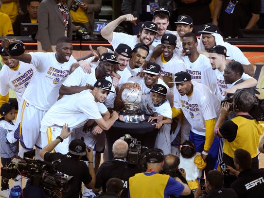 Golden State Warriors players celebrate with the western