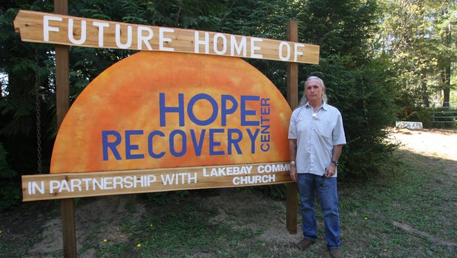 Jeremiah Saucier stands at the entrance to the future Hope Recovery Center campus on the Key Peninsula on Monday. Lakebay Community Church volunteered an 8-acre property for the project.