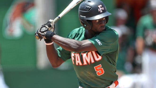 FAMU's Willis McDaniel eyes a pitch against NCA&T at Moore-Kittles Field on Friday May 11, 2018.
