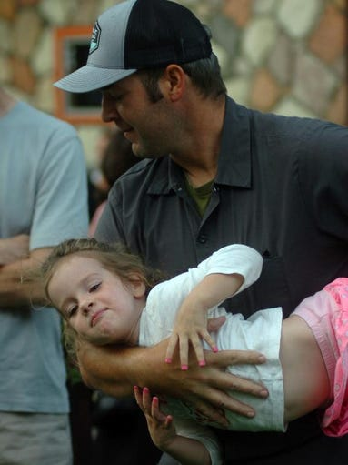 Marc Grassi holds daughter, Franca,3, in arm.