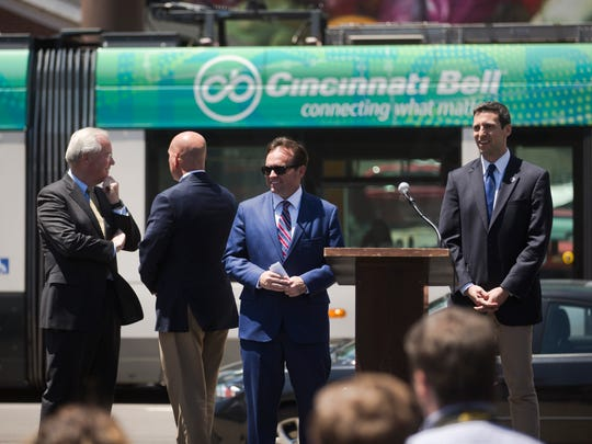 Cincinnati Mayor John Cranley, center, takes part in a press conference in June announcing a new Kroger store will be built Downtown.