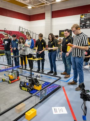 The Atomic Gears competing at Locust Grove in December, where they qualified for the state championship.