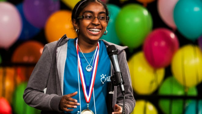 """Nila Dhinaker smiles after spelling """"salvific"""" to win Arizona's spelling bee Saturday."""