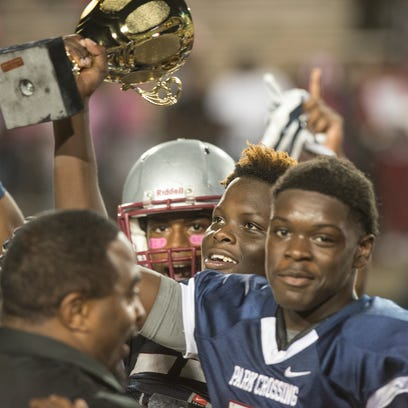 Park Crossing players hold their trophy for winning