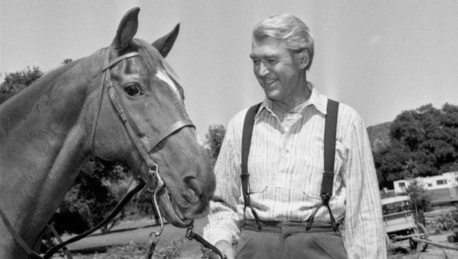 """File: Jimmy Stewart has been with Pie, his movie horse since he started his comeback in 1950 with a western, """"Winchester 73."""""""