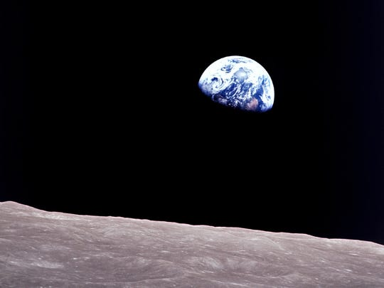 One of the most influential photos of all time is this color picture, called Earthrise, snapped by Apollo 8 astronaut Bill Anders on Christmas Eve 1968.