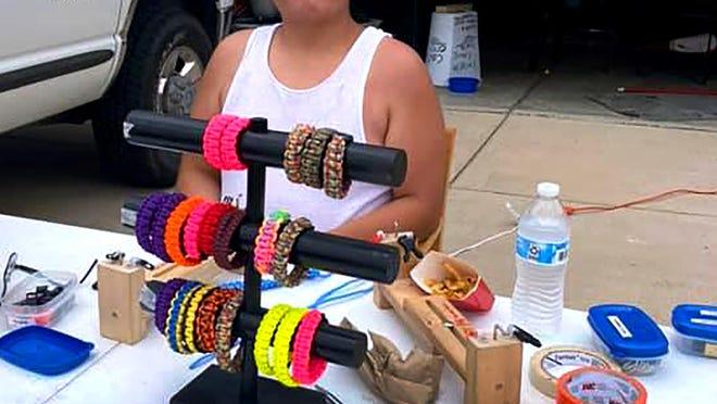 Josiah Aguilar sells paracord bracelets in front of his Pueblo West home to raise funds for the nonprofit 420autism program.