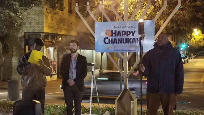 From left: Sylvester Formey, Rabbi Zalman Refson, then-Alderman Van Johnson at the menorah lighting in 2017. Johnson, now Savannah's mayor, will attend the 2020 event that will be virtual for the public to watch on Facebook and local TV stations.