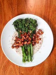 Charred Broccolini with tahini sauce and roasted almonds