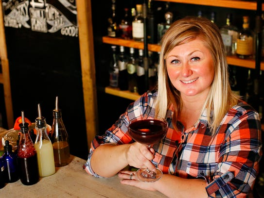 Assistant Manager and Bar Manager Mandy Schriver mixes