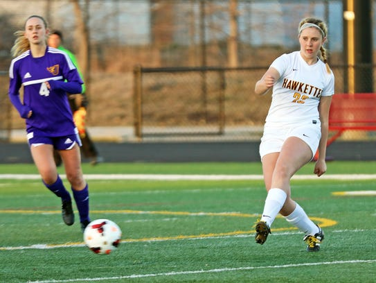 Ankeny senior midfielder Alexis Legg (22) passes to her teammate as the Johnston Dragons compete against the Ankeny Hawkettes in a top Class 3A soccer match on April 17, 2018 at Ankeny High School.