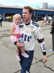 Brad Keselowski, with daughter Scarlett, credits Earnhardt