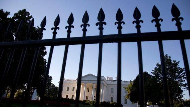 FILE - In this Sept. 22, 2014, file photo, the White House is photographed from Pennsylvania Avenue in Washington. (AP Photo/Carolyn Kaster, File)