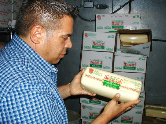 Patrick Martinez buys premium mozzarella in bricks