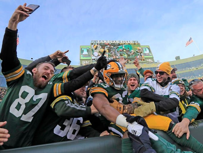 Green Bay Packers running back Aaron Jones (33) celebrates