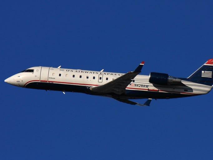 A US Airways Express Bombardier CRJ200 departs Boston