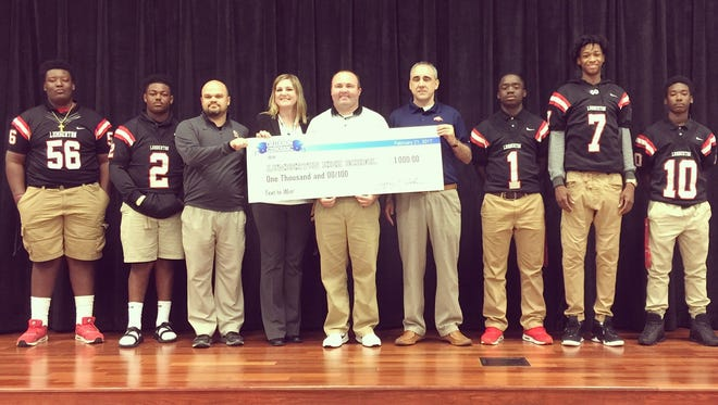 """Lumberton High School recently received $1,000 to use for its physical education department. Lumberton won the """"Gridiron Classic Text-It-To-Win-It"""" competition during the state football championship in December."""