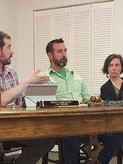 Winooski City Councilors, from left, Brian Sweeney, Brian Corrigan and Nicole Mace on Monday discuss new designs for a proposed downtown hotel. Councilor Eric Covey, off camera, also participated in the discussion. Photographed May 16, 2017.