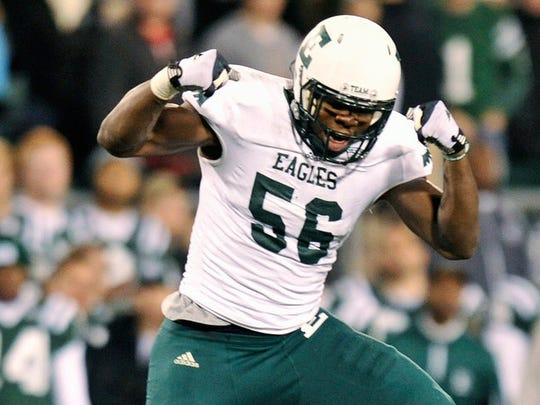 Andy Mulumba of the Eastern Michigan Eagles  celebrates after an interception during a Nov. 1, 2012 game.
