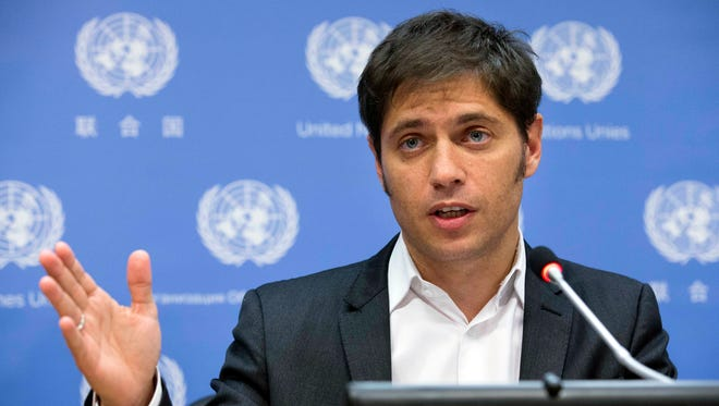 Argentine Economic Minister Axel Kicillof speaks during a news conference at United Nations headquarters, Wednesday, June 25, 2014.