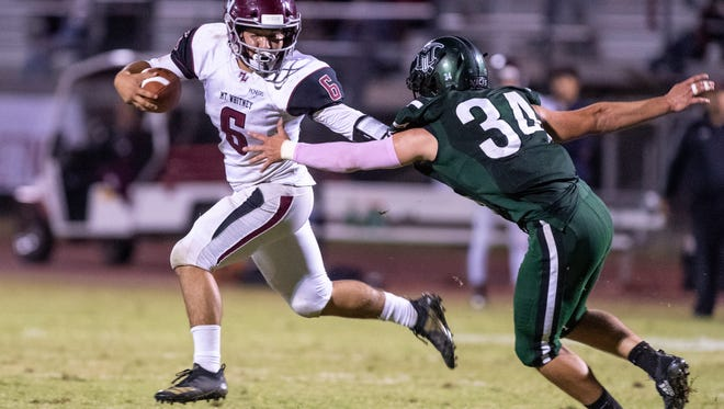 Mt. Whitney's Jaedyn Pineda fends off El Diamante's Donovan MacDonald in a West Yosemite League high school football game on Friday, October 12, 2018.
