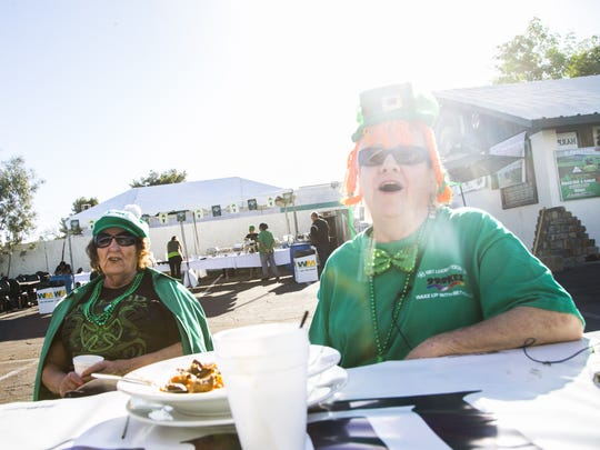 Judy Winters (left) and Barbara Gant relax after eating some morning Irish Stew at Rosie McCaffrey's during St. Patrick's Day in Phoenix on Thursday, March 17, 2016.