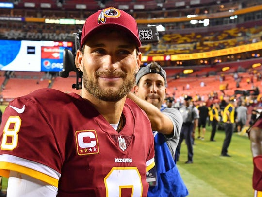Washington Redskins quarterback Kirk Cousins (8) smiles after the game against the Oakland Raiders at FedEx Field.