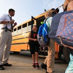 West Clark Superintendent Chad Schenck greets students getting off of buses outside of Silver Creek Elementary School on Wednesday morning on the first day of classes in the district. July 29, 2015