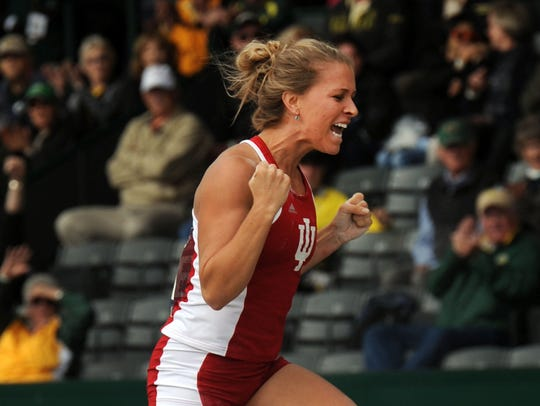 FILE – Kelsie Ahbe, of Indiana, celebrates after clearing